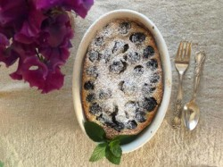 cherry clafoutis in an oval baking dish