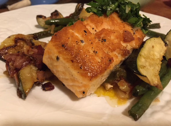 Pan fried salmon with pancetta roasted vegetables.